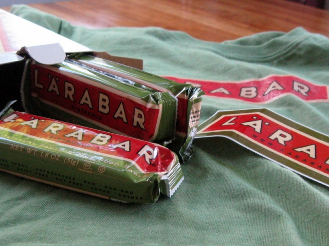3 Lara Bars, a sticker and a t-shirt