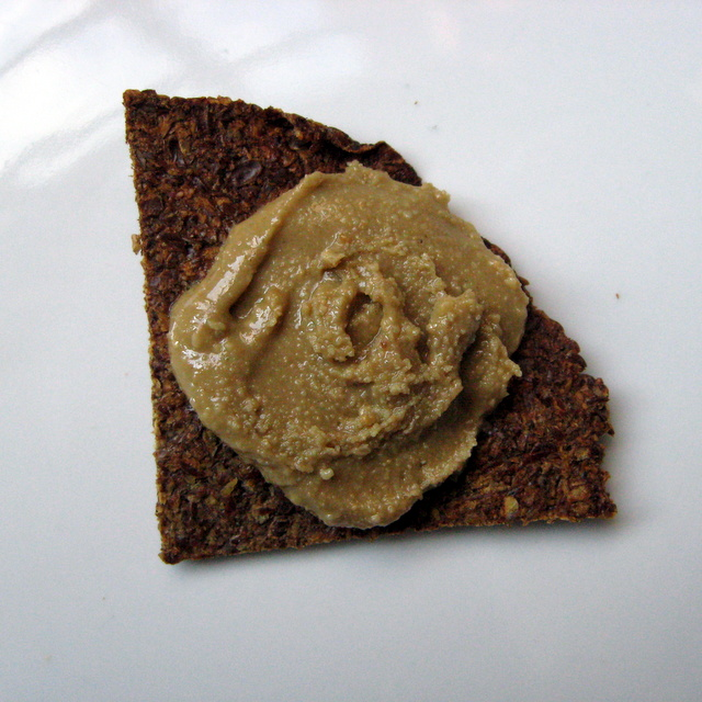 Lucuma-sweetened Sunbutter on a flax seed chip